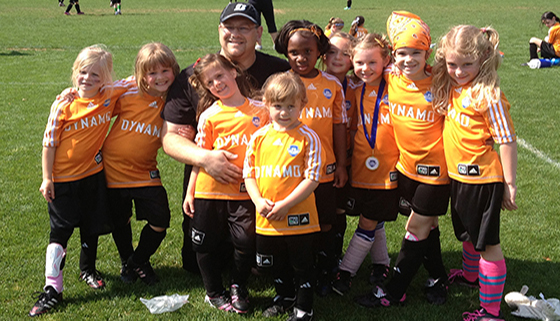 Coach Shane Snively with his soccer team, the Dynamos